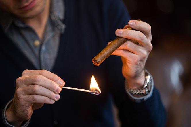 light-a-cigar-toasting-foot-with-match-1.jpg